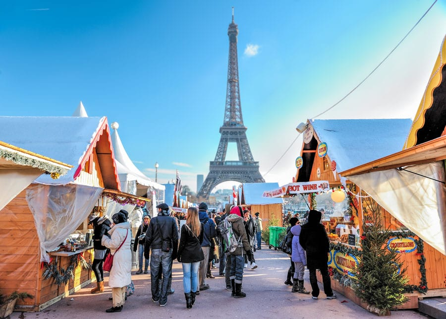 go christmas market shopping in paris with a view on the eiffel tower