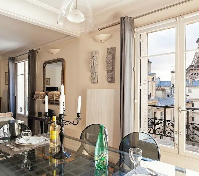 Best Airbnbs in Paris Eiffel Tower View elegant apartment dining room