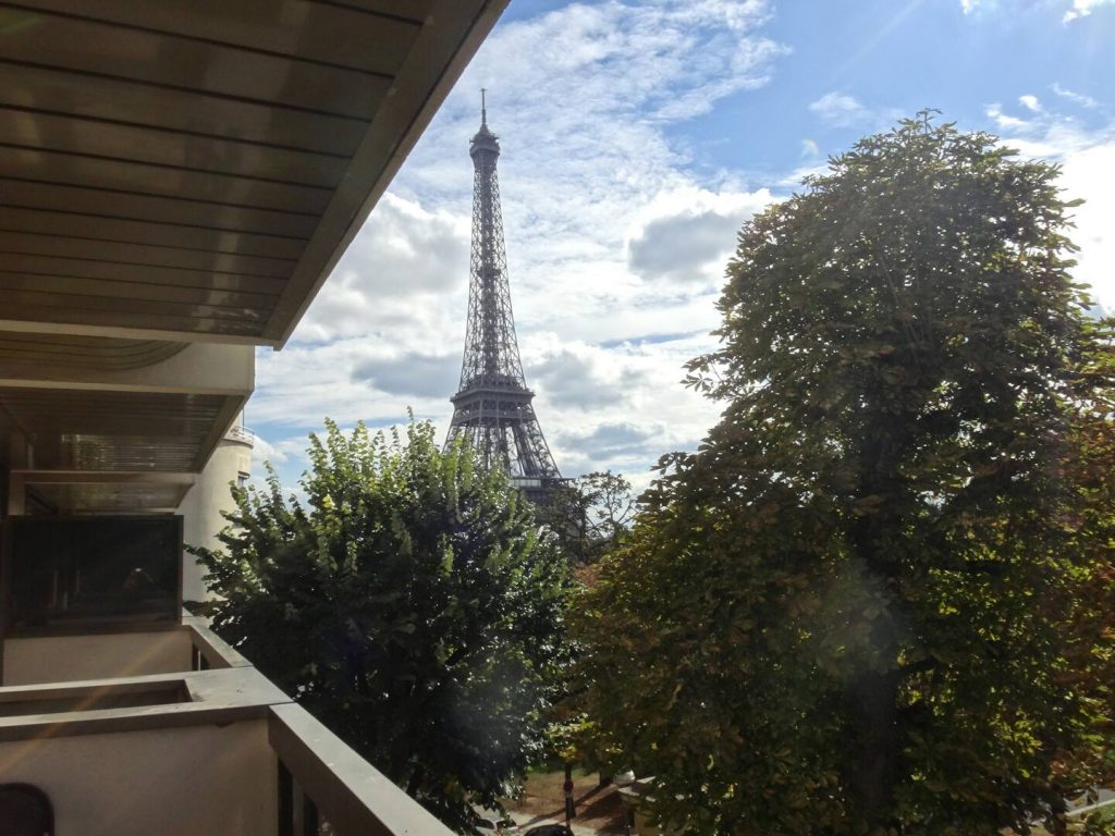 airbnb eiffel tower from balcony trees