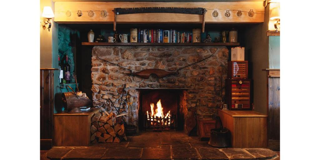 best hotels in honiton blue ball inn fireplace